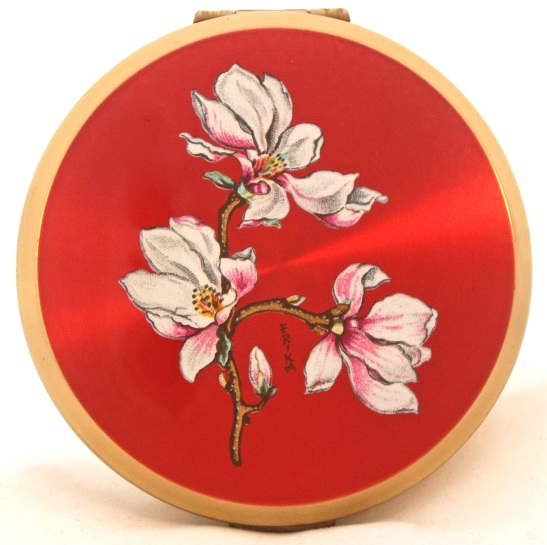 """A red lacquered 1960s Stratton """"Glamorizer"""" compact"""