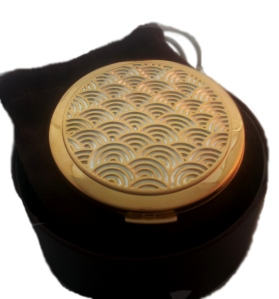 Stratton's classic Art Deco wave compact in its round chocolate box
